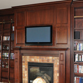 Paneled Library with fireplace surround and rolling ladder, built-in: stained gl