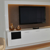 Entertainment Center, built-in: hand rubbed, high gloss lacquer with upholstered