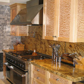 Kitchen, built-in: granite, natural maple and quilted maple.