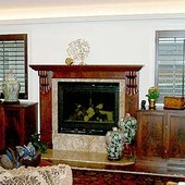 Fireplace with Storage Cabinets, built-in and freestanding: stained mahogany and