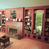 Bookcases and Fireplace Surround, built-in: granite, stained cherry with black l